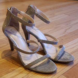 Metalltic strappy heels in excellent condition!